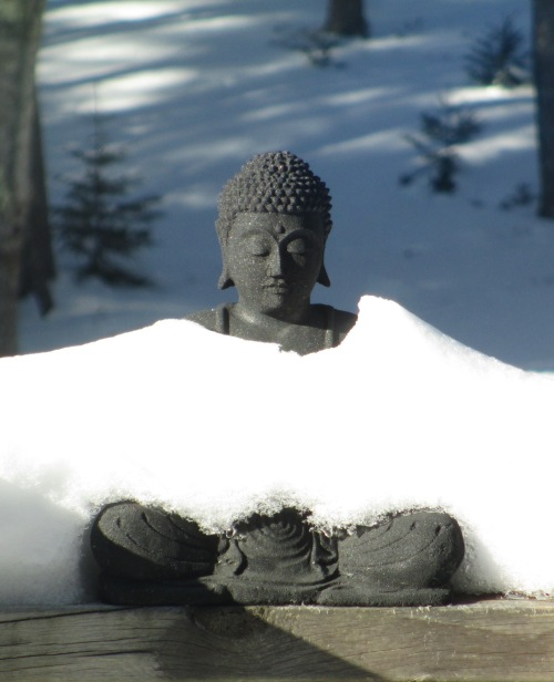 Buddha figure in a snowdrift.